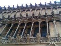 Notre Dame cathedral gargoyles overlooking the market,Dijon
